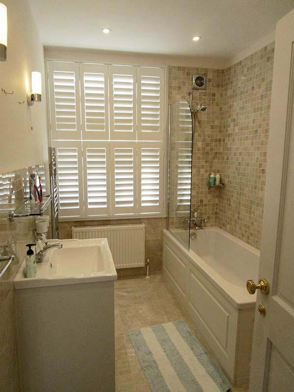 Family bathroom marble tiling shutters
