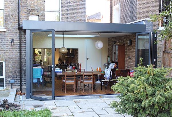 Rear extension bi-folding sliding glazed doors